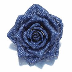 SAPPHIRE BROOCH, 'LA ROSE DE BOURBON', MICHELE DELLA VALLE  .    Designed as a rose, set with circular-cut sapphires, mounted in white gold and titanium, signed Michele della Valle and numbered, case.
