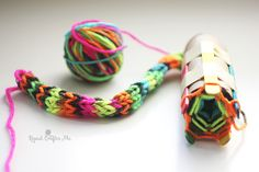 """I've been busy working on setting up a project for my sons 1st grade class! It's an easy """"knitting"""" project that is perfect for elementary age kids. With a cardboard roll, tape, and popsicle sticks,you can set up a simple loom. Then just like you would finger weave, you wrap the yarn around the tops …"""