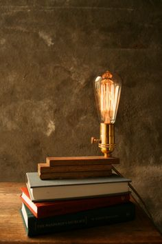 edison desk lamp. etsy.    http://www.etsy.com/listing/86840354/wood-lamp-diy-book-lamp-industrial-light