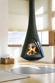 Pharos Interior - Rotatable open-fire wood stove from Harrie Leenders