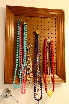 DIY Framed Necklace Organizer - but I think I would paint the pag board a fun color.