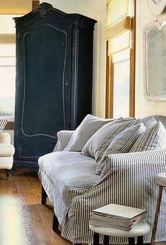 Dreamy Black Armoire and Ticking Stripe Sofa. love this black armoire. Striped Sofa, Ticking Stripe, Ticking Fabric, Jones Design Company, Living Spaces, Living Room, Painted Furniture, Modern Furniture, Navy Furniture