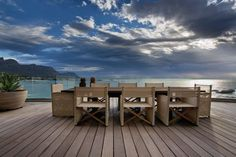 The Roda director chair on the deck of a beautiful Antoni and Associates home in Clifton, Cape Town - South Africa. Photography by: Adam Letch