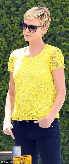 Charlize Theron at West Hollywood in a bright yellow top and skinny jeans, May 2013.