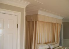 An over the bed cornice with three piece crown moulding.