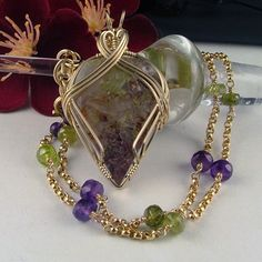Ava Designs - Wire Wrapped Multi Colored Moss Agate Pendant Necklace--I like the way the necklace is strung with gold beads and stones.