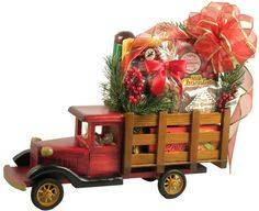 This is one of our very unique holiday gift baskets , and it is sure tomake a very special delivery indeed! Our Special Delivery Truck Holiday Gift Basket will deliver holiday cheer and blessings in the grandest way possible. Imagine their delight as this high-end, handcrafted truck rolls in carrying a very special load of gourmet treats and goodies. $79.99  http://www.littlegiftbasketboutique.com/item_1194/Special-Delivery-Truck-Holiday-Gift-Basket.htm