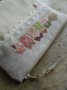 cross stitch finishing - I like this idea for a small bag.
