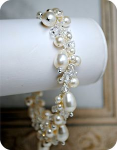 Pearl Bridal Bracelet, Swarovski Crystal and Pearl Bracelet, Cluster, Drape, Teardrop Pearls, Bridal Jewelry, Wedding Bracelet, Sparkle. $79.00, via Etsy.