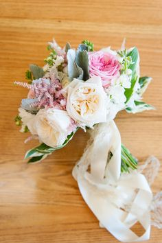 Hand tied Bridal Bouquet with Garden Roses, Peonies, Astilbe, Hosta, Dusty Miller and Stock.