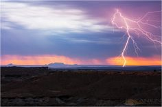 """My son shot this this morning looking toward Page, AZ.  The rock formation in the back is what locals call """"The Sleeping Chief""""  Nice work!L  ightning and the Chief 