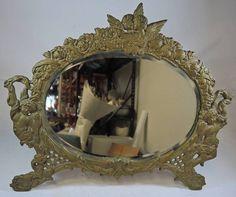 Outstanding Jennings Bros. Large Oval Brass Putti Cherubs Vanity Mirror