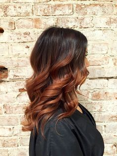 Dark brown to coppery red. Obsessed.