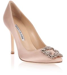 Nude satin evening pump with a rose crystal embellished ornament from Manolo…