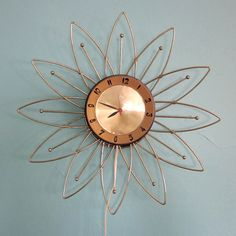 Sunburst Clock | 1950s, this, but I would like the nicest pretzel clock you can. One for me. about 200. nice as possible.