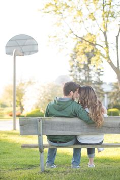 Engagement session photo ideas; basketball courts at the park and team sweatshirts. by Awakened Light Photography, Michigan.