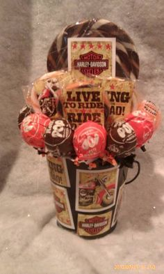 One made to order Harley Davidson Lollipop Bouquet. A unique gift idea for someone young or old or great table centerpieces at your next party/Gathering.  **Bucket is reusable** **Lollipops are all edible**