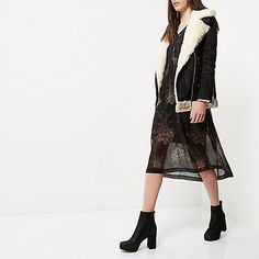Faux suede with faux fur lining Oversized fit  Shearling collar Asymmetric zip front Long sleeves with zip cuffs Zip side pockets and buckled hem This style is also available in the RI Plus collection