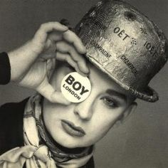 ۞ Boy George, born George Alan O'Dowd in1961, is an English singer-songwriter, who was part of the English New Romanticism movement which emerged in the late 1970s to the early 1980s. His music is often classified as blue-eyed soul, which is influenced by rhythm and blues and reggae. During the 1980s, Boy George was the lead singer of the Grammy and Brit Award winning pop band Culture Club where he became known for his soulful voice and androgynous appearance.