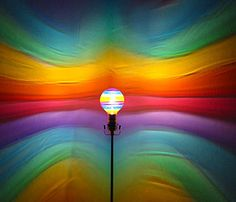 This hand-painted light bulb, created by California artist Felicia Renaud, reflect instant murals on wall. Visual Elements Of Art, Porch Lighting, Wall Lighting, Painted Light Bulbs, Over The Rainbow, Rainbow Light, Nightlights, Rainbow Colors, Rainbow Stuff