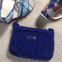 """Vera Bradley Little Hipster NWT Cobalt Blue This authentic Vera Bradley crossbody is in a stunning deep jewel tone blue. The microfiber quilted exterior boasts a front zip wallet compartment with 4 slip card pockets - one clear - and bill section. Magnetic closure on back slip pocket. Top zip opens to interior zip pocket. Adjustable crossbody strap. Coordinating blue, cream and black patterned fabric interior. Perfect for work or play! NWT. Approx 9 3/4""""w x 6 1/2""""h x 1 1/2"""" deep and 55""""…"""