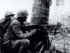 Marine of the 2nd Platoon of Foxtrot Company, Second Battalion, Fifth Marines, fires his M-70 at a strong point of the North Vietnamese Army resistance in the Citadel during the battle of Hue, 18 February 1968. U.S. Marine Corps Photograph – NHHC Photograph Collection, L-File, Vietnam.