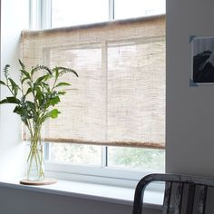 DIY Rustic Burlap Roller Shades. Light coverage, with softened natural light filtering through.