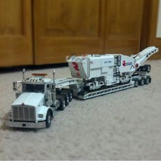 Sword 1:50 scale Kenworth T800 with Rogers lowboy trailer hauling a Roadtec RX-700.