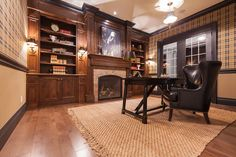 Photo Of A Victorian Home Office Design With Medium Tone Hardwood Floors And