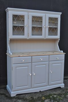 Pine dresser with leaded glazed doors, painted in Farrow and Ball 'Lamp Room Grey'