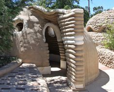 earthbag construction - homes made in developing countries from sand and clay inside of recycled plastic bags, then coated with adobe. Will last generations, are hurricane and earthquake resistant, and they're completely green. Great idea for providing good homes for little money in developing countries.