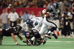 Running back Shaun Alexander of the Seattle Seahawks breaks a tackle on his way towards scoring the gamewinning touchdown against the Atlanta Flacons...