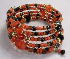 'Red and Black Wrap Bracelet' is going up for auction at 12pm Sat, Aug 4 with a starting bid of $10.