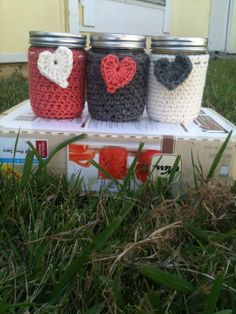 Set of three mason jars in crocheted sleeves with heart tags. Made these with acrylic yarn. So fun and simple to make! I played around with texture, so each sleeve is slightly different.