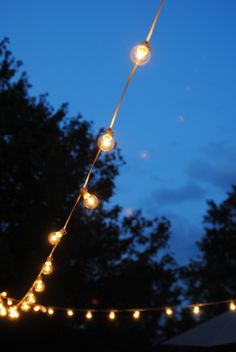 LOVE THIS: how to hang outdoor lights! What an easy and inexpensive way to add magic to your deck, patio or party. no pergola or fancy DIY skills needed! Backyard Lighting, Patio Lighting, Landscape Lighting, Lighting Ideas, Lighting Design, String Lighting, Overhead Lighting, Kitchen Lighting, Bathroom Lighting