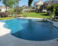 Custom designed vanishing edge pool with Mexican travertine pool deck pavers.