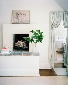 Living Room Photo - A mantel decorated with a painting of a bulldog