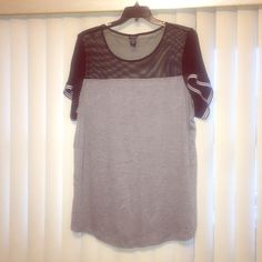 Netted t shirt Super comfy shirt with netting at the top. Worn once. torrid Tops Tees - Short Sleeve