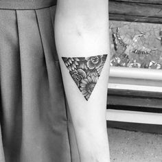 Floral triangle tattoo on the inner forearm. Tattoo artist: Akauã Pasqual