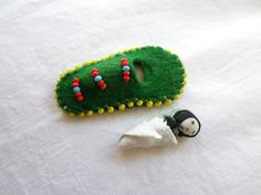 This pin is a vintage Native American papoose pin! There is a surprise inside! The baby doll is removable! The doll even has a blanket wrapped around it.  https://www.etsy.com/listing/488662857/green-felt-beaded-native-american