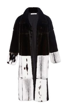 This **Oscar de la Renta** coat features a mink fur body in a patchwork design with a fold over collar and an A-line shape.