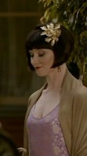 Phryne Fisher; great series from Australia. Miss Fisher's Murder Mysteries.