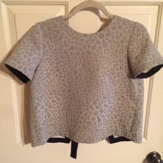 Tibi top Tibi jaquard leopard grey short sleeve top. Part of a set (matching skirt also available) may be purchased separately or together! Worn a couple times but remains in perfect condition! Tibi Tops Blouses