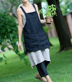 This is a shorter and lighter version of our linen Square-Cross apron. Easy to put on apron that slips over your head with no sashes to tie. Made of medium weight linen with a large front pocket. Accommodates most sizes and allows for easy movement. For the kitchen, garden, craft room or a stylish gift.  This listing is for Regular size only:  XL size can be ordered here: https://www.etsy.com/listing/259265038/linen-criss-cross-apronpinaforeno-ties?ref=shop_home_active_10   -pre-washed…