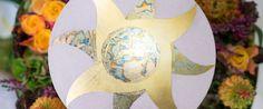Urnendeckel mit von Hand aufgebrachter Sonne aus Schlagmetal und Blattgold