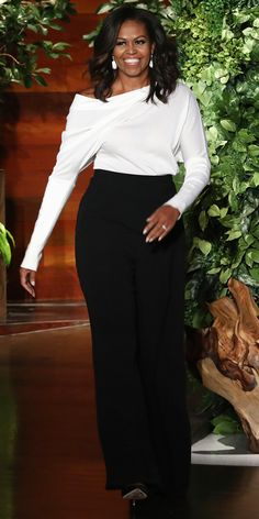 Look of the Day - Michelle Obama in an off-the-shoulder Tom Ford blouse and luxe trousers also by the designer.