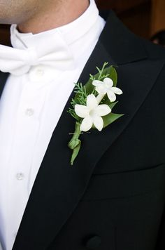 Delicate and fragrant stephanotis blossoms, nestled in a crisp ivy leaf for this boutonniere, add a refined touch to a white-tie ensemble.