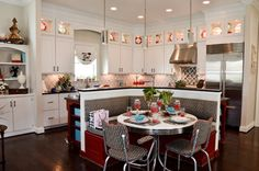 Kitchen design by A. Dodson's, love the built in breakfast nook and the backsplash.