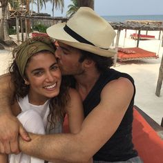 Ian showered his wife with kisses and a tight hug while on vacation.