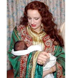 Princess Lalla Salma of Morocco is pictured holding her son, the newborn, Crown Prince Moulay Hassan at the royal palace in Rabat on 15 May 2003.